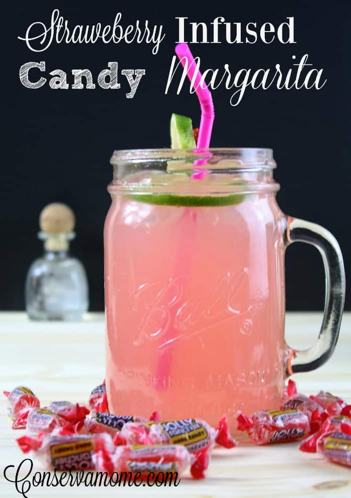 A delicious and easy recipe for Strawberry Infused Candy Margarita. The perfect drink for summer or when you need to ream of summer.
