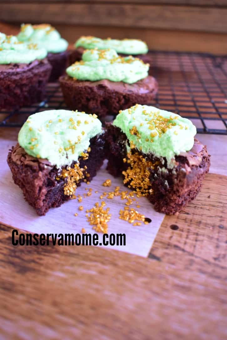 These delicious Pot-O-Gold Brownie Cupcakes are the perfect St.Patrick's Day Dessert! will be a hit at any fun St.Patrick's day event. Made with deliciousness and filled with a magical surprise these will be a fun treat for everyone to enjoy.