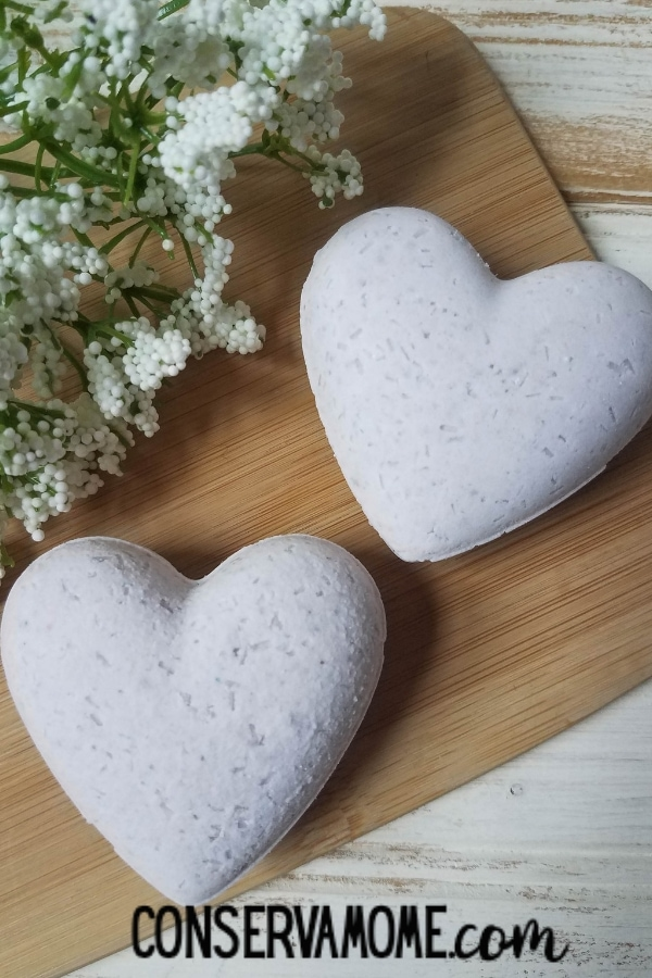 lavender scented heart bath bombs on wooden board