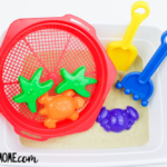Sensory Beach Bin With Toys: Beach Themed Sensory Bin Activity